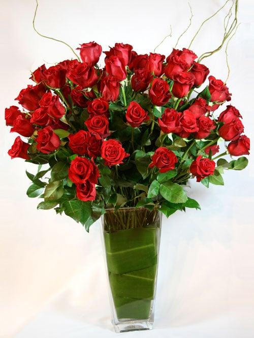 A Beauty of 100 Vased Long-Stemmed Red Roses